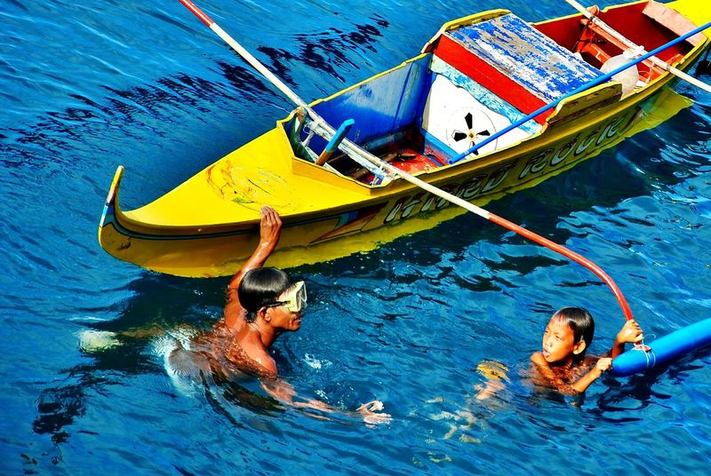 Sisid Barya Boys City Blue Boat Boys Day Mode Of Transportation People Port Area Port Area Sea Transportation Two People Water Yellow