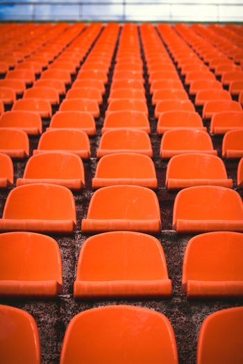 Empty orange seats at stadium
