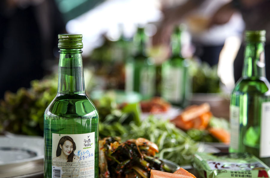 Abundance Alcholic Beverage Bottle Carrot Close-up Day Focus On Foreground Glass Bottle Green Color Kimchi Lettuce Lettuce In My Garden Life Style Multi Colored No People Preparing For Party Selective Focusing Sesame Leaf Soju Still Life Vegetable Whisky