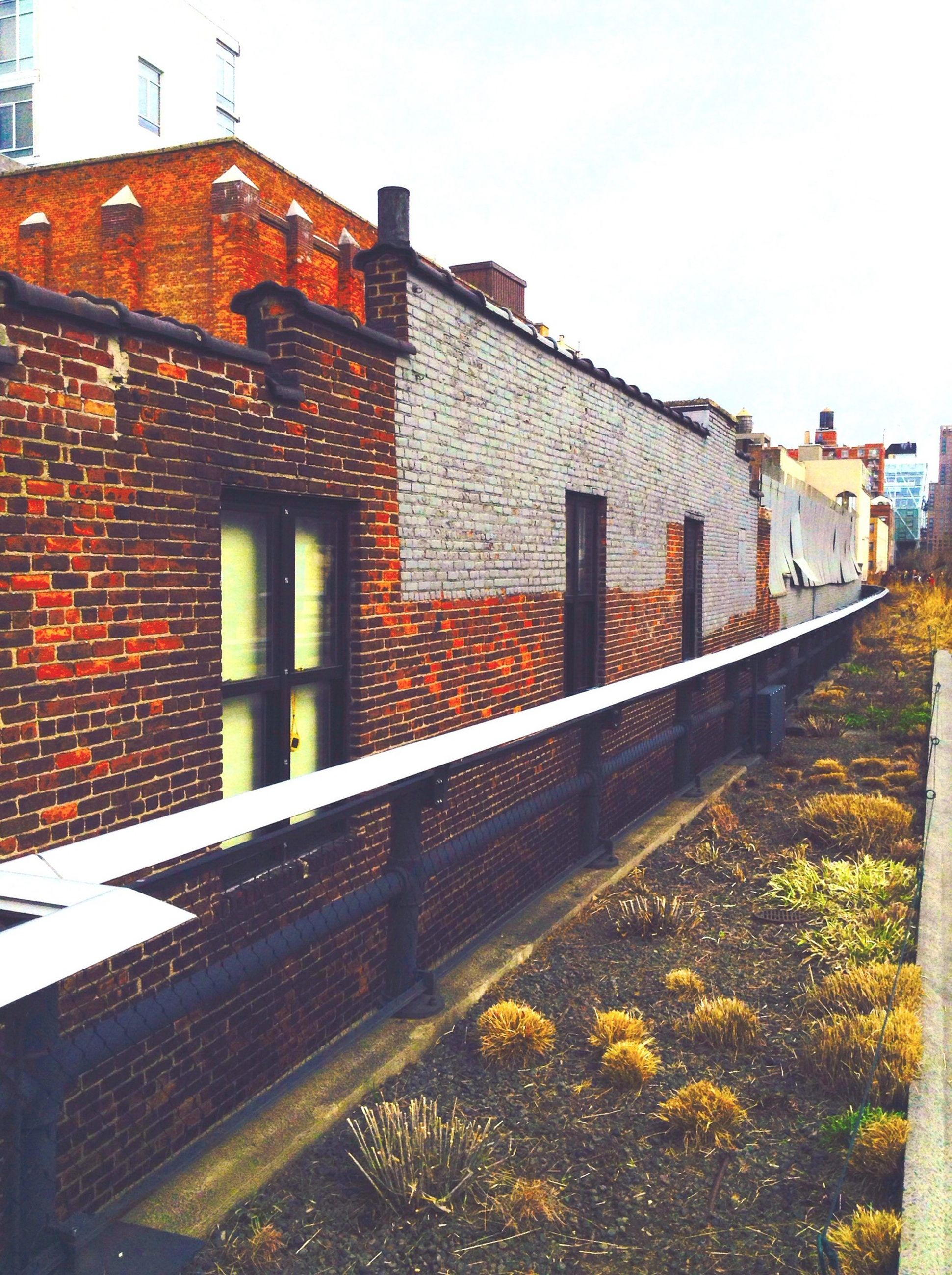 architecture, built structure, building exterior, house, the way forward, clear sky, residential structure, brick wall, wall - building feature, outdoors, day, building, no people, sky, residential building, railing, low angle view, diminishing perspective, exterior, old
