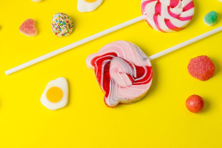 Candy Colored Background Creativity Dessert Directly Above Food Food And Drink Freshness High Angle View Indoors  Indulgence Multi Colored No People Red Still Life Studio Shot Sweet Sweet Food Temptation Unhealthy Eating Yellow