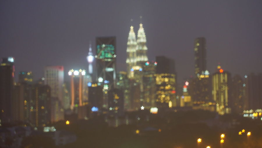 Malaysia city skyline illuminated at night.Blurry photo light and bokeh. Architecture Building Building Exterior Built Structure City Cityscape Financial District  Illuminated Modern Nature Night No People Office Office Building Exterior Outdoors Sky Skyscraper Spire  Tall - High Tower Urban Skyline