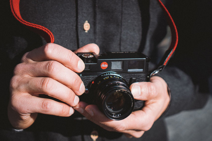 Lifestyle Camera Camera - Photographic Equipment Day Digital Camera Holding Human Hand Leica Men Midsection One Person People Photographer Photographing Photography Themes Portable Information Device Real People Technology Wireless Technology