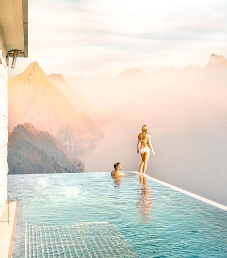 People on swimming pool against sky