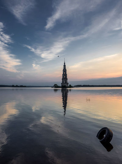 Mid distance view of kalyazin bell tower in volga river during sunset