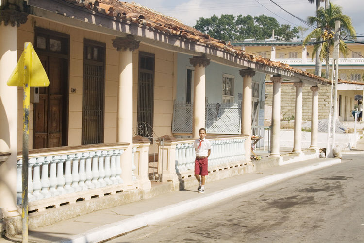 Cuba Cuba Collection Architectural Column Architecture Boy Building Building Exterior Built Structure Casual Clothing Day Front View Full Length Lifestyles Looking At Camera Nature One Person Outdoors Real People Walking Women Young Adult Young Women