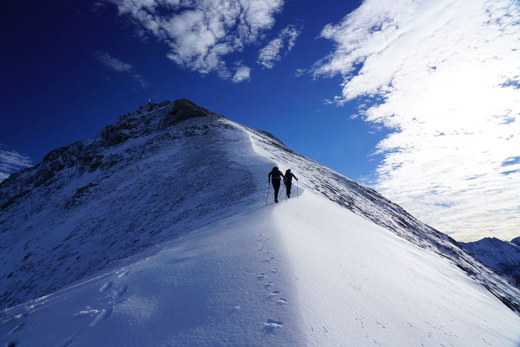 Snow Mountain Winter Scenics - Nature Sky Cold Temperature Leisure Activity Beauty In Nature Snowcapped Mountain Real People Non-urban Scene Nature Day Lifestyles Tranquil Scene Mountain Range Tranquility Cloud - Sky Unrecognizable Person Extreme Weather Outdoors