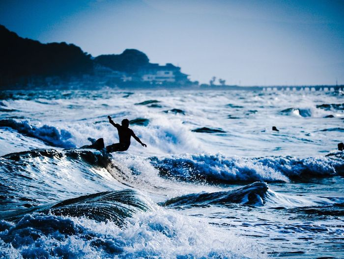 EyeEm Selects Sea Wave Water Motion Nature Surfing Extreme Sports Outdoors Beauty In Nature Sky Sport Skill  Scenics Day Adventure Mountain Horizon Over Water Animal Themes No People Mammal