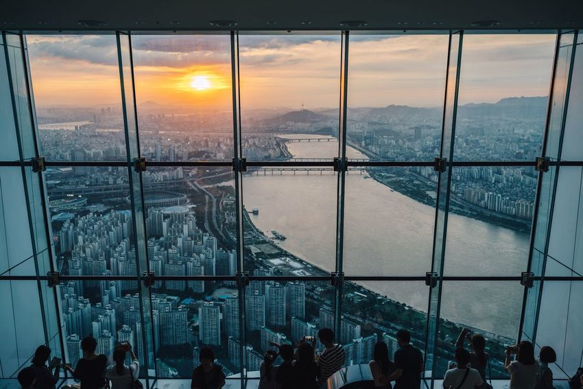 Sunset of the metropolis 🌇 Window Sky Sunset Indoors  Built Structure Cloud - Sky Cityscape Large Group Of People Architecture Scenics City Real People People Skyline Skyscraper Lotteworld Tower Han River Seoul Korea Observation Point Orange Sky Seoul Sky View From Above Mix Yourself A Good Time Lost In The Landscape