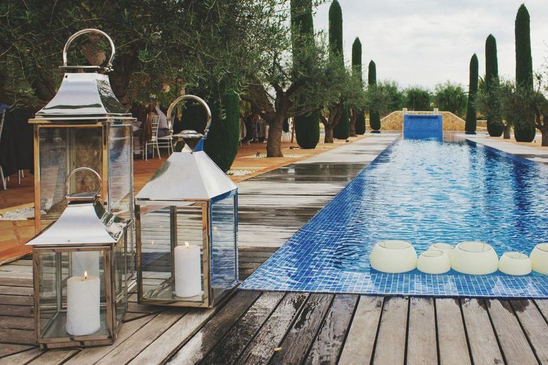 Water Outdoors Tree Day No People Swimming Pool Sky Ibiza Ibiza España. Pool Wedding Venue Sunset Holiday Tranquil Scene Candles