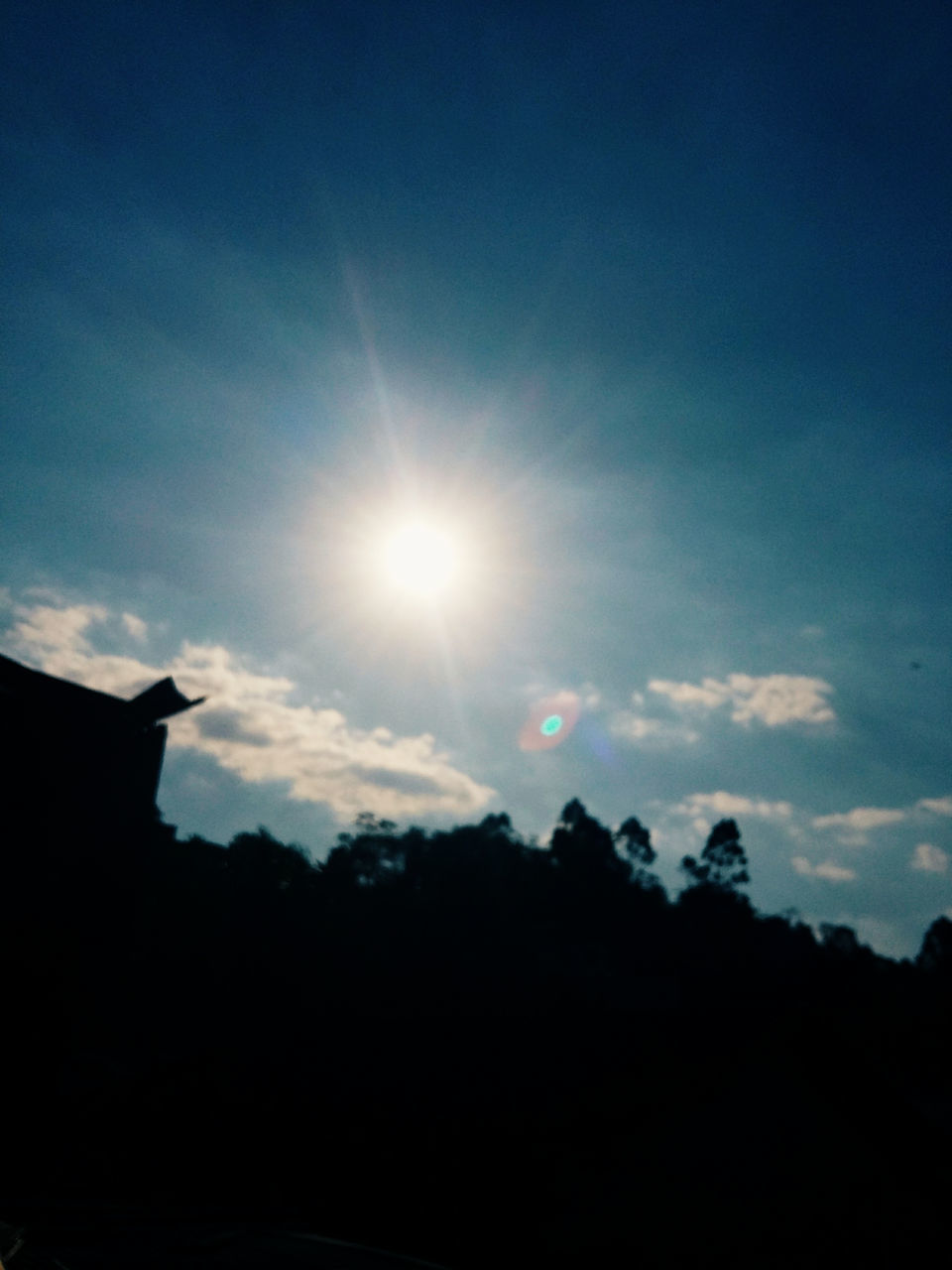 sun, silhouette, sky, nature, lens flare, sunbeam, beauty in nature, sunlight, no people, sunset, tranquility, scenics, outdoors, cloud - sky, tranquil scene, low angle view, day