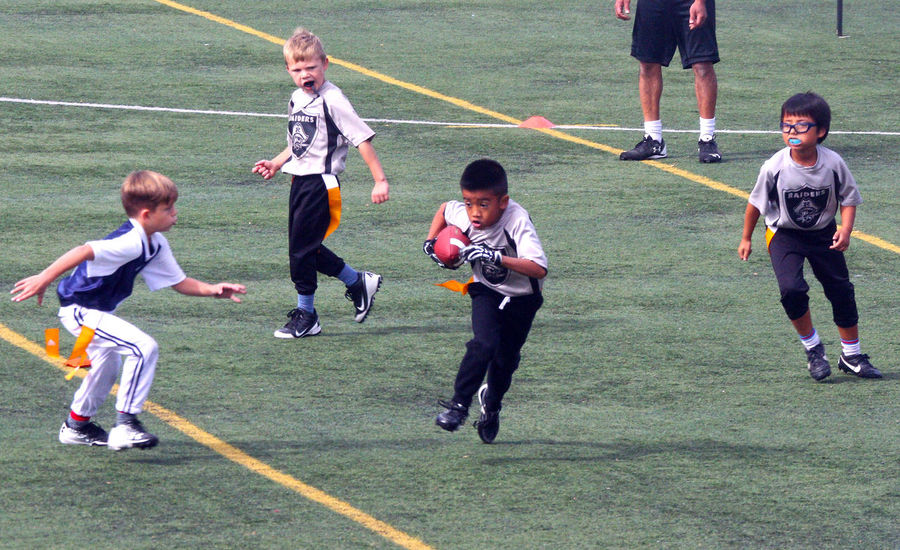 Junior Football in Minoru Park Richmond B.C. Canada Childhood Sport Boys Competition Sports Uniform Grass Canada Richmond B.C. Junior Football Competitive Sport Teamwork Athlete Running