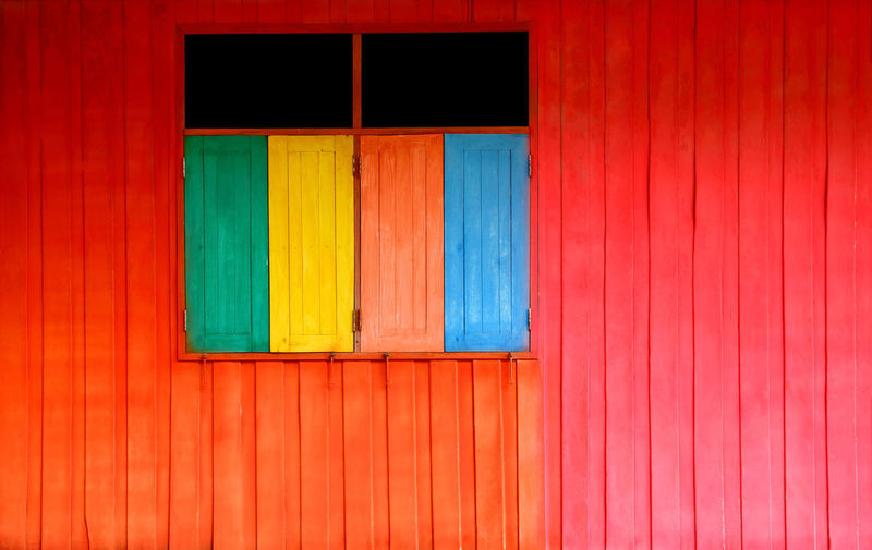 colorful wood wall Architecture Blue Building Building Exterior Built Structure Closed Day Door Entrance House Multi Colored No People Orange Color Outdoors Red Security Vibrant Color Wall - Building Feature Window Wood - Material
