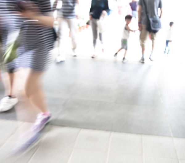 Human Leg Low Section Motion Real People Walking Lifestyles Women Group Of People Blurred Motion Body Part Human Body Part Shoe Day People City Flooring on the move Incidental People Medium Group Of People Adult Human Foot Tiled Floor