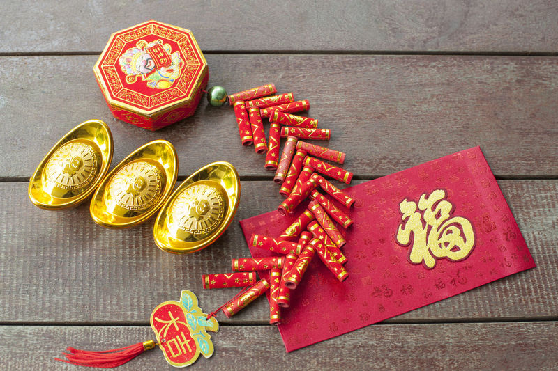 An embroidered red packet and some decorations for Chinese New Year. It's auspicious to prepare them for the festive season. Arrangement ASIA Asian Culture Auspicious Celebration Chinese Chinese New Year Close-up Colorful Colourful Culture Day Embroidery Festival Ingots Luck Multi Colored No People Oriental Red Red Packet Season  Still Life Tradition Traditional