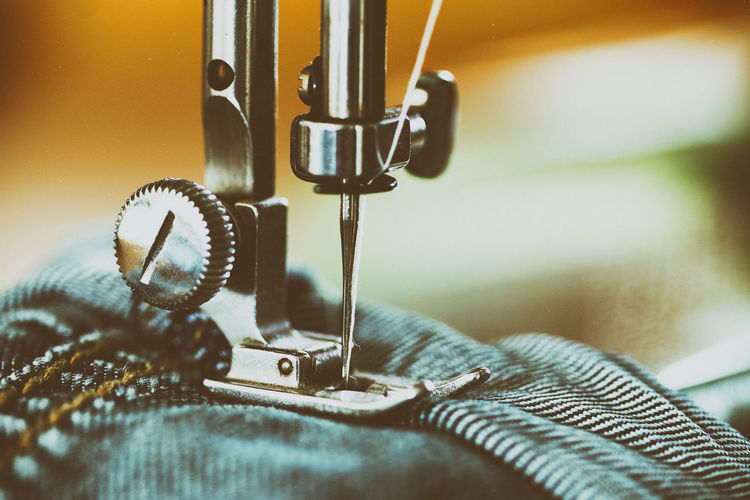 Close-Up Of Jeans In Sewing Machine