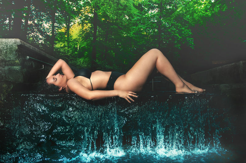 Green Beautiful Woman Bikini Blue Full Length Italian Model Leisure Activity Life Balance Lifestyles Lying Down Nature One Person Outdoors Plant Posing Real People Relaxation Sensual_woman Swimming Pool Tree Water Waterfront Women Young Adult Young Women