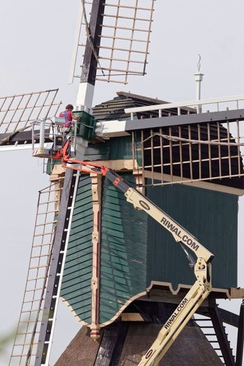 Windmill PaintJob Built Structure Architecture Day Wood - Material Building Exterior Outdoors No People Water Sky
