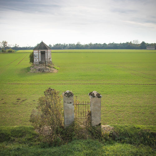 Field Grass Landscape Land Sky Architecture Plant Built Structure Nature Day No People Green Color Cloud - Sky Outdoors Environment History Building Exterior Rural Scene Abandoned Old The Past Portal Entrance Field Agricultural Field Old Building