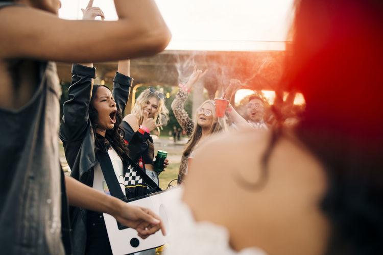 People enjoying music concert