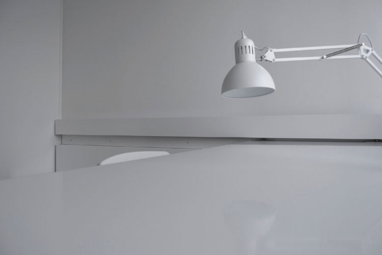 Desk Architecture Close-up Contemporary Design Electric Lamp Electricity  Indoors  Interior Design Light Light Fixture Lighting Equipment Low Angle View Minimalism No People Office Room Simplicity Single Object White Color