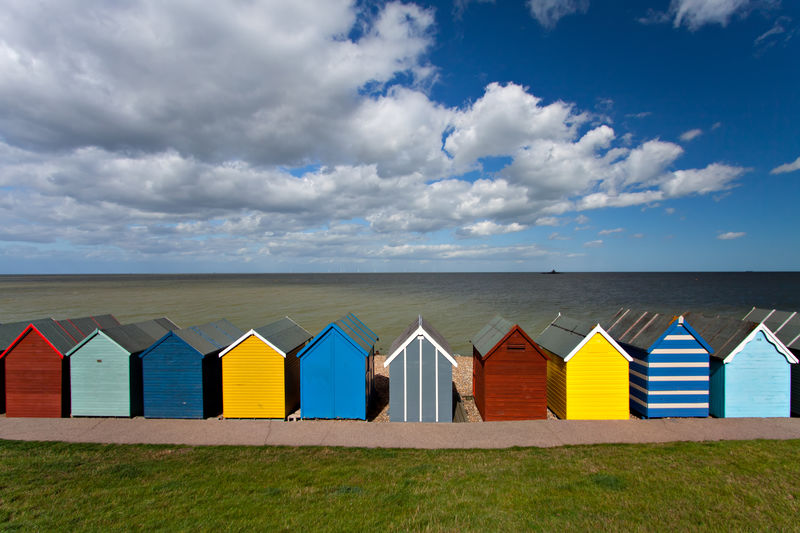 Multi colored beach huts in uk