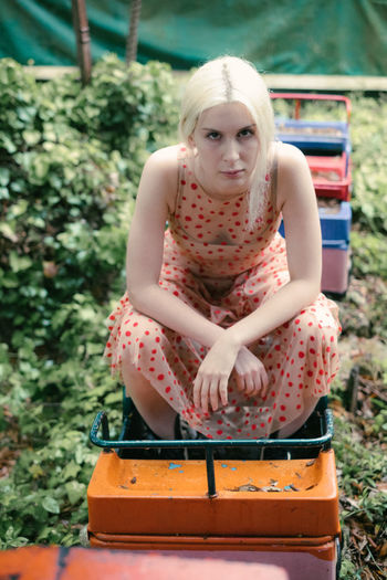 Portrait Of Young Woman Sitting On Miniature Train