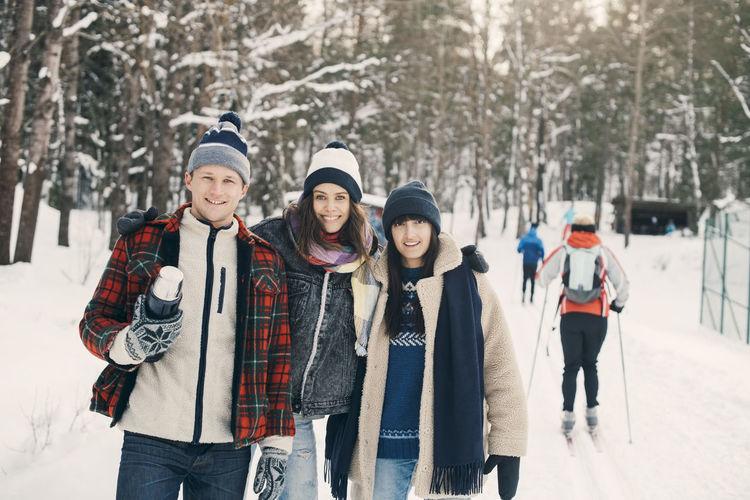 Portrait of people standing in snow
