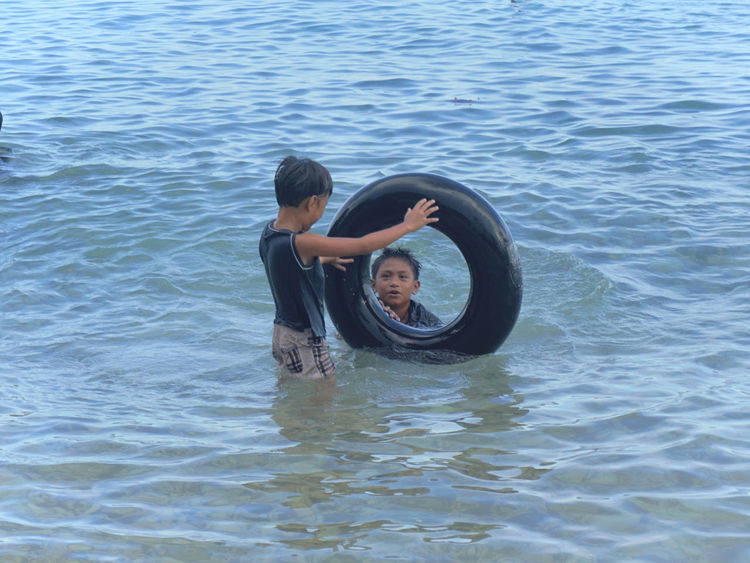 My nephews were enjoing the beach using the Interior tube as lifebuoy locally called as 'Salbabida' 10 Beach Water Sea Boys Inflatable Ring Inflatable  Float Floating On Water Floating Rippled