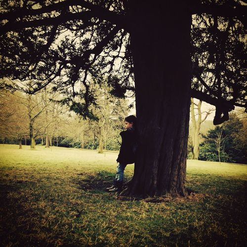 As he looked into the distance, he realised that he was alone... Model Hugging A Tree Boy Thinking