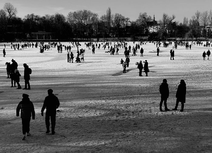 Group of people on field in park