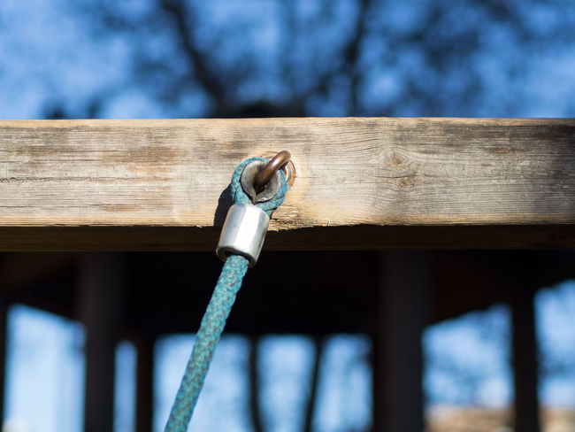 raccorda Axis Blur Background Children Park Close-up Cord Day Hook Light Blue Metal No People Outdoors Park Playground Sky Tree Wood Wood - Material Wood Floor