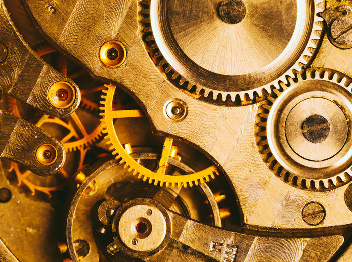 Clockwork Background. Close-up Of Old Clock Watch Mechanism With Gears Gear Metal Machine Part Watch Clockworks Technology Teamwork Gold Colored Antique Pocket Watch Backgrounds Wheel Brass Clock Engine Retro Yellow Time Detail Instrument Machine Old Concept
