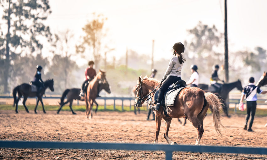 People riding horses in ranch