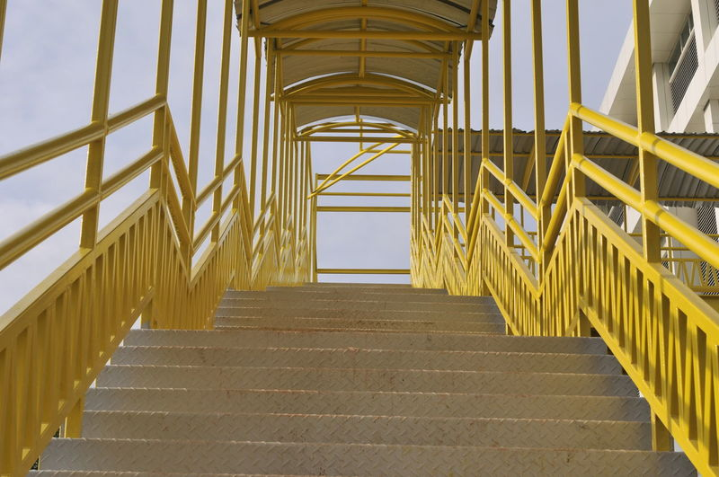 stairs Yellow Stairs Politics And Government Modern Yellow Architecture Palace Spiral Staircase Spiral Spiral Stairs Directly Below Bannister Colonnade Past Spiral Galaxy Architectural Column Arch Architectural Feature Tall - High Tower