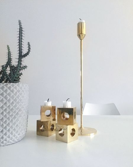 Candlestick holder on table against wall at home