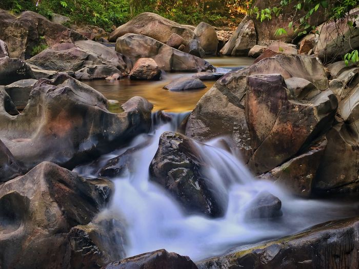 Water Waterfall Tree Motion Forest Long Exposure River Rock - Object Landscape Flowing Rock Falling Water Rapid Flowing Water Stone Rock Formation Geyser Stream Rugged Stream - Flowing Water Natural Landmark Rafting Surf Boulder Power In Nature Hot Spring Coast