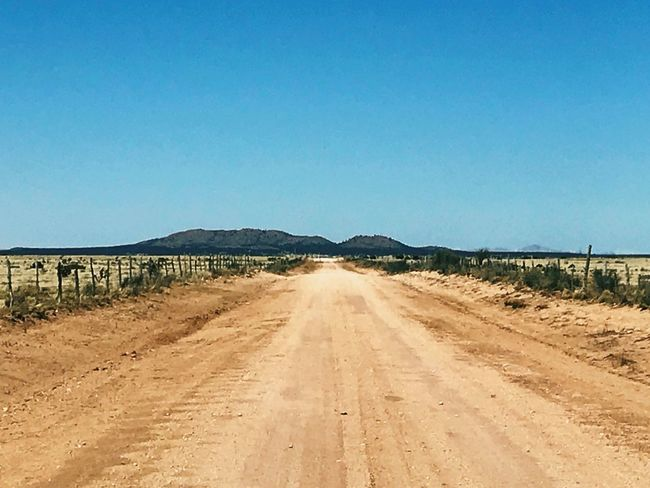 """""""Dirt Road To Cedarvale"""" In these parts more often than not it's dirt roads to destination. vanishing point New Mexico Photography New Mexico Skies New Mexico Blue Sky Rural Scene Rural Country Road Dirt Road The Way Forward Clear Sky Road Outdoors Day Blue Landscape Scenics Sky No People"""