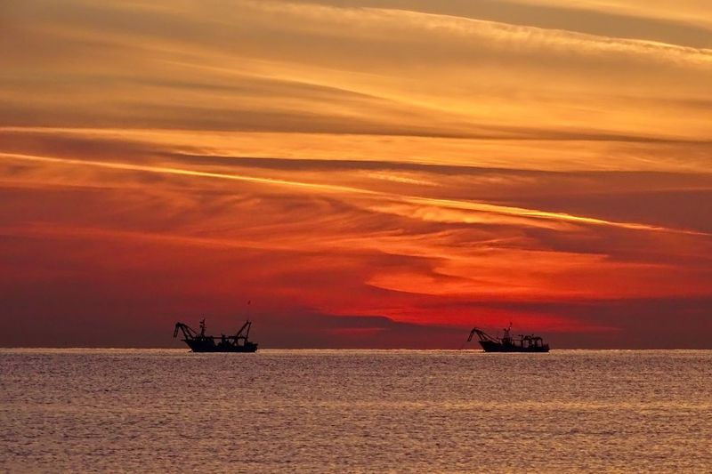 Sunrise Fishing Boat Travel Travel Destinations Sunset Sky Orange Color Cloud - Sky Beauty In Nature Transportation Scenics - Nature Tranquil Scene Mode Of Transportation Dramatic Sky Silhouette Nautical Vessel Water Horizon Horizon Over Water Tranquility Sea Outdoors Nature Idyllic