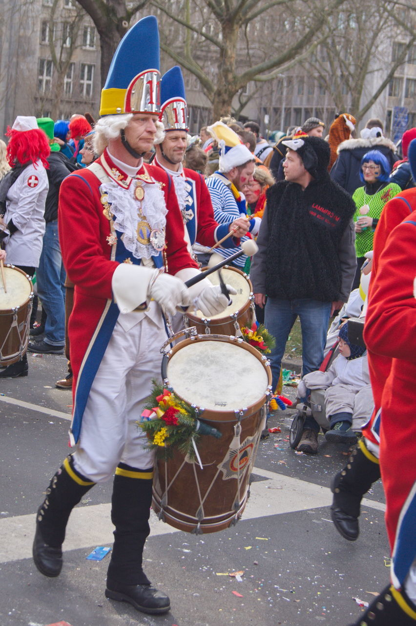 music, musical instrument, arts culture and entertainment, drum - percussion instrument, men, large group of people, togetherness, day, real people, outdoors, musician, celebration, playing, performance, crowd, full length, drummer, adult, people
