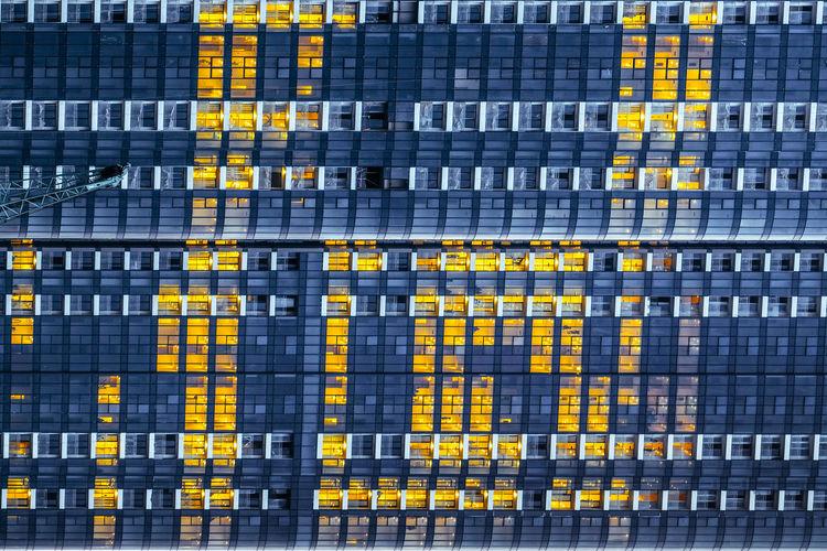 Full frame shot of yellow office building