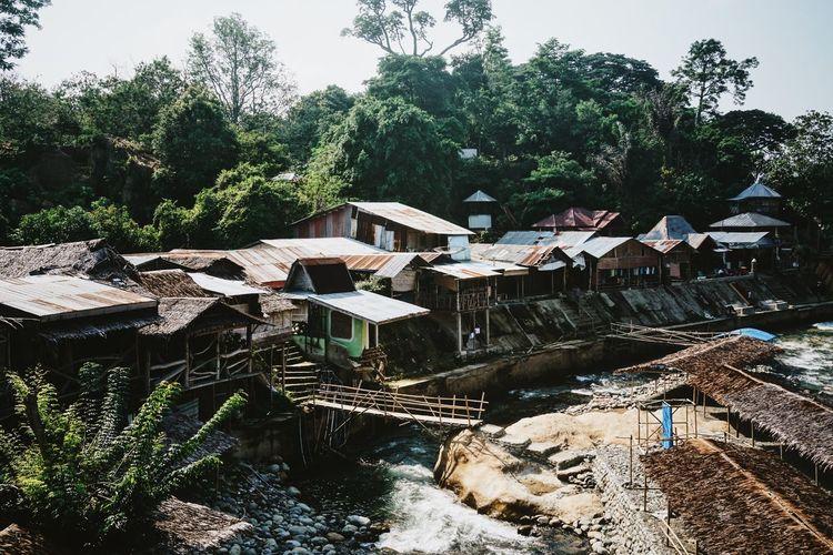ASIA Bukit Lawang Corrugated Iron Roofs Forest Gunung Leuser National Park INDONESIA Nissen Hut Rainforest River Sumatra  Sunny Day Traveling Village
