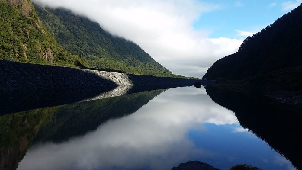 The perfect reflection at Fox Glacier Beauty In Nature Cloud - Sky Day Mirror Lake Mountain Mountain Range Nature No People Outdoors Reflection Lake Scenics Sky Tranquil Scene Tranquility Water