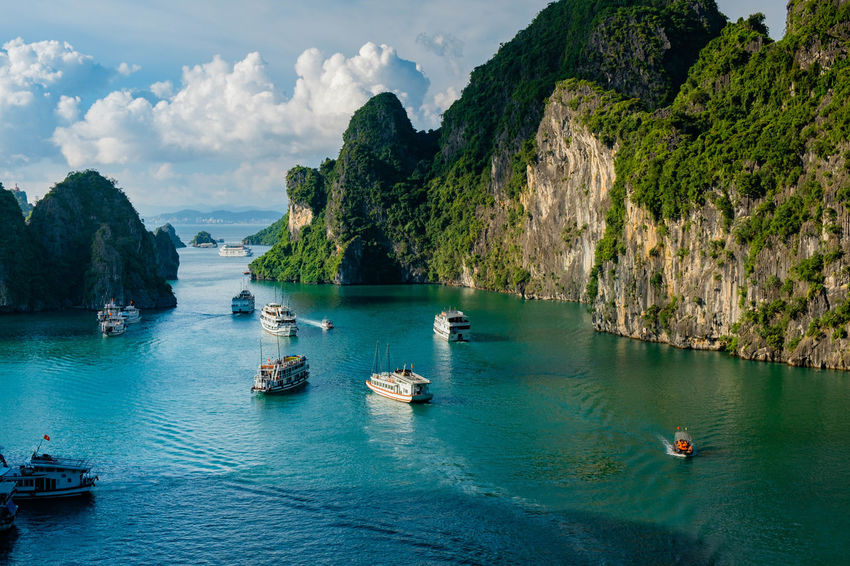A view over Ha Long Bay as seen from Sung Sot Cave. Vantage Point Beauty In Nature Boat Cloud - Sky Day High Angle View Longtail Boat Mode Of Transport Moored Mountain Nature Nautical Vessel No People Outdoors Rock - Object Rock Formation Sailing Scenics Sea Tranquil Scene Tranquility Transportation Travel Destinations Water Waterfront
