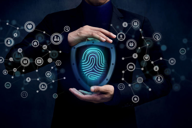 Digital composite image of businessman with fingerprint security system