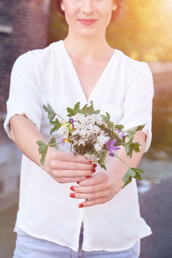 Adult Adults Only Bouquet Day Flower Fragility Freshness Happiness Holding Human Hand Light Effect Love Nature One Person One Woman Only One Young Woman Only Only Women Outdoors People Portrait Standing Women Young Adult Young Women EyeEmNewHere Long Goodbye The Portraitist - 2017 EyeEm Awards BYOPaper!