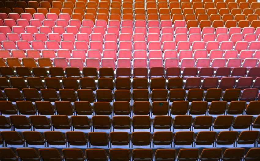 Full Frame Shot Of Empty Red Chairs In Stage Theater