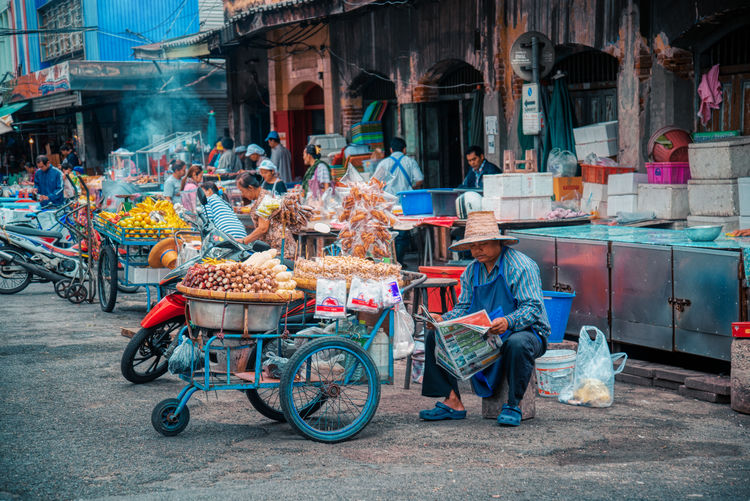 Man cycling for sale at market stall