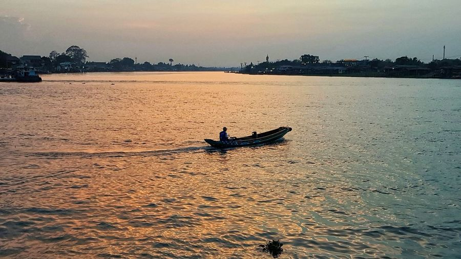 Sunset Nautical Vessel Silhouette Outdoors One Person Transportation Kayak Vacations One Man Only Sky Water Nature People Only Men Day Adults Only Adult Thailand Photos EyeEm Gallery Travel In Thailand Bangkok Thailand. Thailand