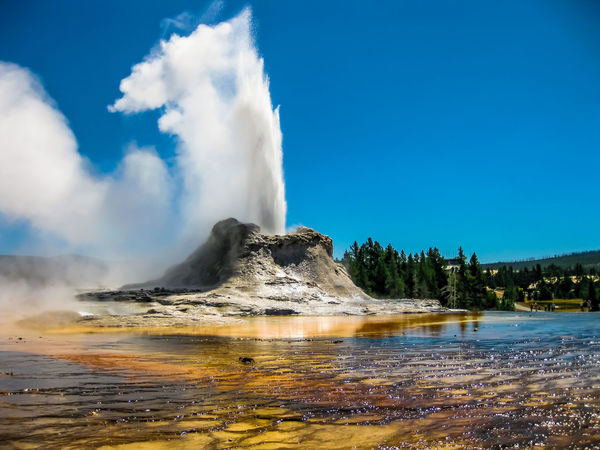 Closeup of Morning Glory Pool, a hot spring in the Upper Geyser Basin in Yellowstone National Park, Wyoming and Montana, United States. Castle Geyser erupts with hot water and steam with pools of thermophilic bacteria and is a cone geyser in the Upper Geyser Basin of Yellowstone National Park, Wyoming, United States. Dramatic view of dead trees and travertine terraces rock formations made of crystallized calcium carbonate in Mammoth Hot Springs, Yellowstone National Park in Wyoming and Montana, United States. Gaiser Grand Prismatic Lake Wyoming Landscape Yellowstone Yellowstone National Park Yellowstone National Park. Beauty In Nature Cloud - Sky Day Erupting Geology Geyser Grand Prismatic Grand Prismatic Spring Hot Spring Lake Landscape Motion Nature No People Outdoors Park Physical Geography Pool Power In Nature Scenics Sky Smoke - Physical Structure Steam Tranquil Scene Tranquility Travel Destinations Volcanic Landscape Volcano Vulcano Water